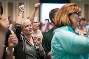 """Parents participate in the """"O-H-I-O!"""" cheer during Bobcat Student Orientation on Thursday, June 4, 2015.  Photo by Ohio University  /  Rob Hardin"""