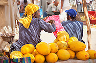 Men selling canary melons at the market in Zagora, Morocco.