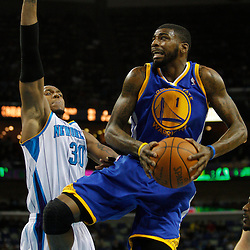 January 5, 2011; New Orleans, LA, USA; Golden State Warriors small forward Dorell Wright (1) shoots over New Orleans Hornets power forward David West (30) during the second half at the New Orleans Arena. The Warriors defeated the Hornets 110-103.  Mandatory Credit: Derick E. Hingle