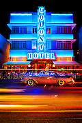 The Colony Hotel, designed by Henry Hohauser in 1935, stands today on Ocean Drive, an icon in the Tropical Deco style for which this historic Miami Beach neighborhood is famous. A 1957 Packard is parked in front. This photograph is from the early 1990s.