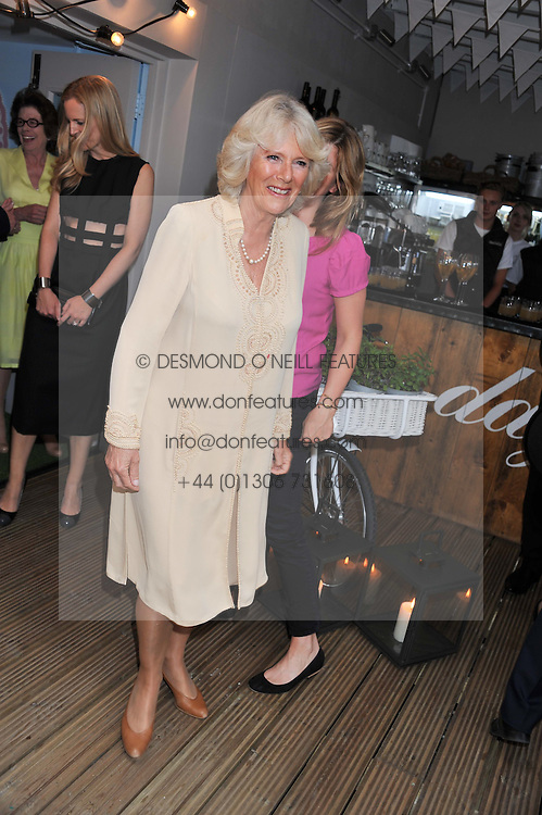 HRH The DUCHESS OF CORNWALL at a party to celebrate the publication on 'Let's Eat: Recipes From My Kitchen Notebook' by Tom Parker Bowles held at Selfridge's Rooftop. Selfridge's, Oxford Street, London on 27th June 2012.