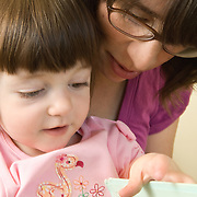 HV, Mom and Girl in Doctor Office Reading Book