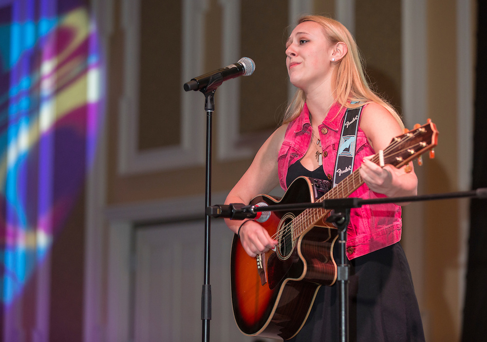 Brenna Innocenzi, an Ohio University student, performs at the International Women's Day Festival on March 13, 2016. Photo by Emily Matthews