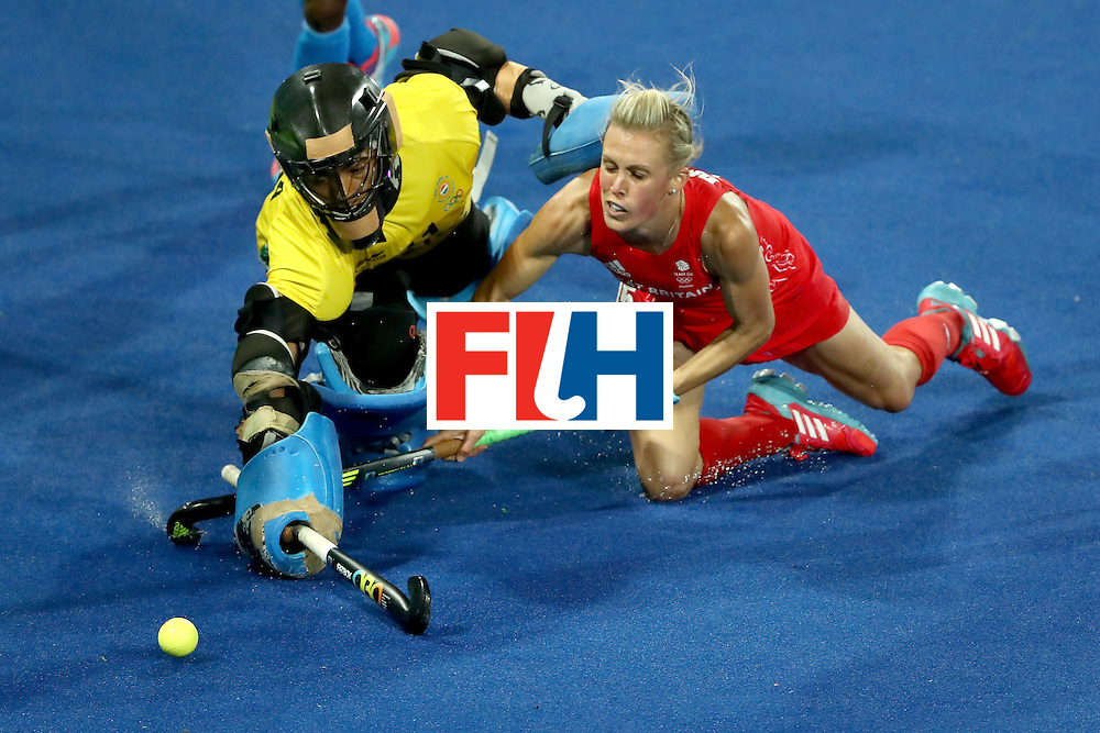 RIO DE JANEIRO, BRAZIL - AUGUST 08:  Savita Savita #11 of India lunges past Alex Danson #15 of Great Britain for a shot on goal during a Women's Pool B match on Day 3 of the Rio 2016 Olympic Games at the Olympic Hockey Centre on August 8, 2016 in Rio de Janeiro, Brazil.  (Photo by Sean M. Haffey/Getty Images)