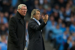 MANCHESTER, ENGLAND - Monday, April 30, 2012: Manchester United's manager Alex Ferguson and Manchester City's manager Roberto Mancini during the Premiership match at the City of Manchester Stadium. (Pic by Chris Brunskill/Propaganda)