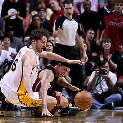 March 10, 2011; Miami, FL, USA; Los Angeles Lakers power forward Pau Gasol (16) and Miami Heat point guard Mike Bibby (0) get tied up going for a loose ball during the fourth quarter at the American Airlines Arena. The Heat defeated the Lakers 94-88.   Mandatory Credit: Derick E. Hingle