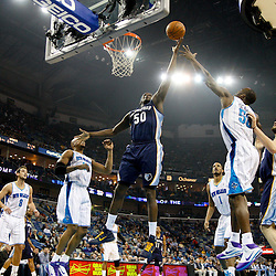 January 19, 2011; New Orleans, LA, USA; Memphis Grizzlies power forward Zach Randolph (50) shoots over New Orleans Hornets center Emeka Okafor (50) during the first half at the New Orleans Arena.   Mandatory Credit: Derick E. Hingle