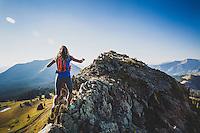 Jari Hiatt negotiates a rocky ridge in Washington Gulch, Crested Butte, Colorado.