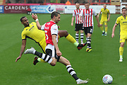 Tyrone Bennett and Aaron Martin during the EFL Sky Bet League 2 match between Exeter City and Cheltenham Town at St James' Park, Exeter, England on 22 September 2018.