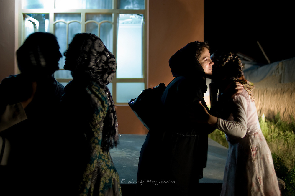 MP Fawzia Koofi is warmly greeted by her family-in-law after arriving in Faizabad coming from Kabul by road. Afghanistan, 2012