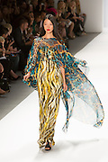 A dramatic gown in bold yellow, black and gray print with a gauzy wrap in a turquise pback and gold print. By Carlos Miele at the Spring 2013 Mercedes-Benz Fashion Week in New York.