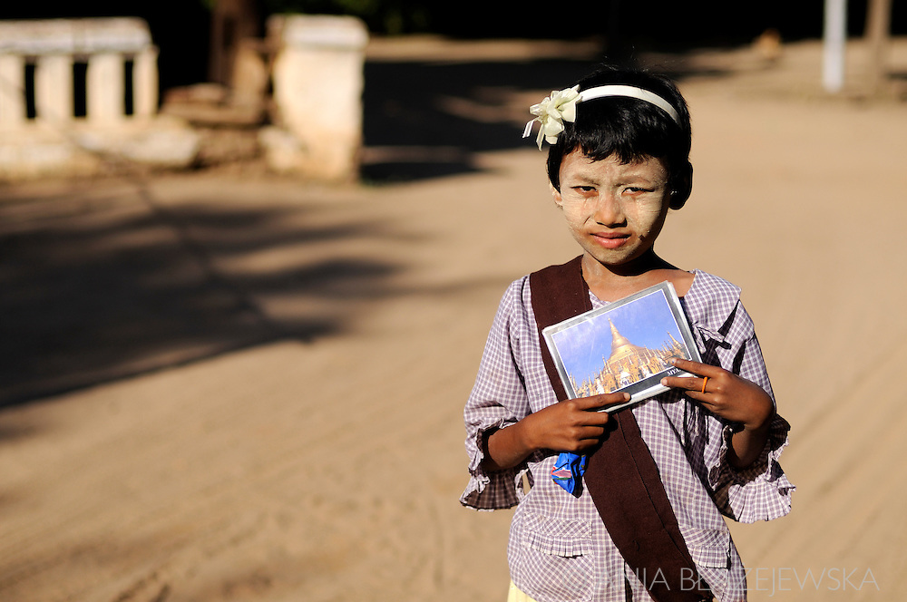 Myanmar/Burma, Bagan. Burmese girl selling postcards in the temples of Bagan.