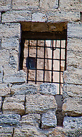 Close-up of a castle window with an iron grille at Chateaurenard, Provence, France.