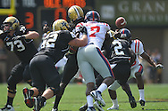 Ole Miss' Wayne Dorsey (7) hits Vanderbilt quarterback Larry Smith (10), forcing a fumble in Nashville, Tenn. on Saturday, September 17, 2011. Vanderbilt won 30-7..