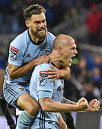 Sporting Kansas City midfielder Graham Zusi (8) and defender Botond Barath (2) celebrate after a Sporting Kansas City goal during the second half against Independiente at Children's Mercy Park.