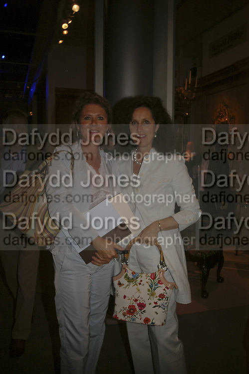 Mrs. Leo Geeris ( bluer)  and Mrs. Charles Pugh, The opening  day of the Grosvenor House Art and Antiques Fair.  Grosvenor House. Park Lane. London. 14 June 2006. ONE TIME USE ONLY - DO NOT ARCHIVE  © Copyright Photograph by Dafydd Jones 66 Stockwell Park Rd. London SW9 0DA Tel 020 7733 0108 www.dafjones.com