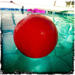Red ball in the pool. Orlando holiday 2012. Photo taken with the Hipstamatic photo application on Apple iPhone 4.