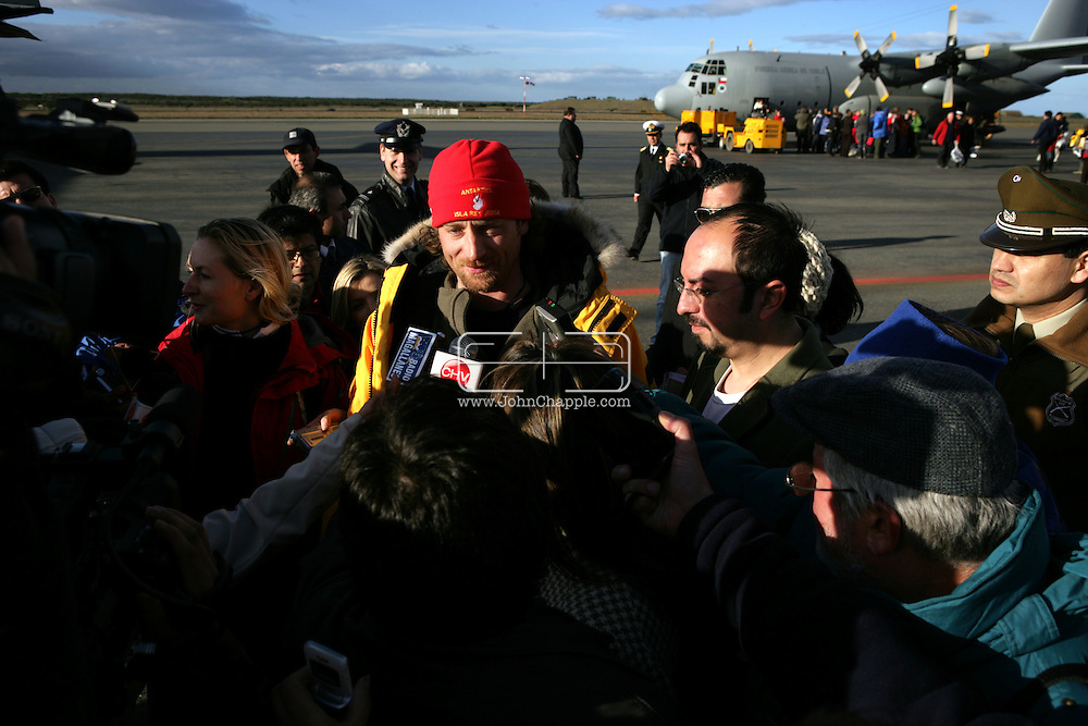 "24th November 2007, Punta Arenas, Chile. Survivors from the shipwrecked Antarctic vessel M/S Explorer arrive at Punta Arenas by military aircraft. 154 tourists and crew had spent the night on King George Island after their ship struck an iceberg and sank approximately 120km (75 miles) north of the Antarctic Peninsula. After several hours bobbing in small lifeboats surrounded by floating sheets of ice, they were plucked to safety by the Norwegian cruise ship, the Nordnorge. The ""Spirit of Shackleton"" 19-day cruise through the Drake Passage, cost from around $8,000 (£3,900) per cabin. Pictured is Jan Heikel and fiance Mette Larsen from Denmark. Jan had intended to propose  to Mette the next day but when the ship started to sink he grabbed the ring and proposed of the lifeboat. She said yes..PHOTO © JOHN CHAPPLE / REBEL IMAGES.john@chapple.biz   www.chapple.biz"