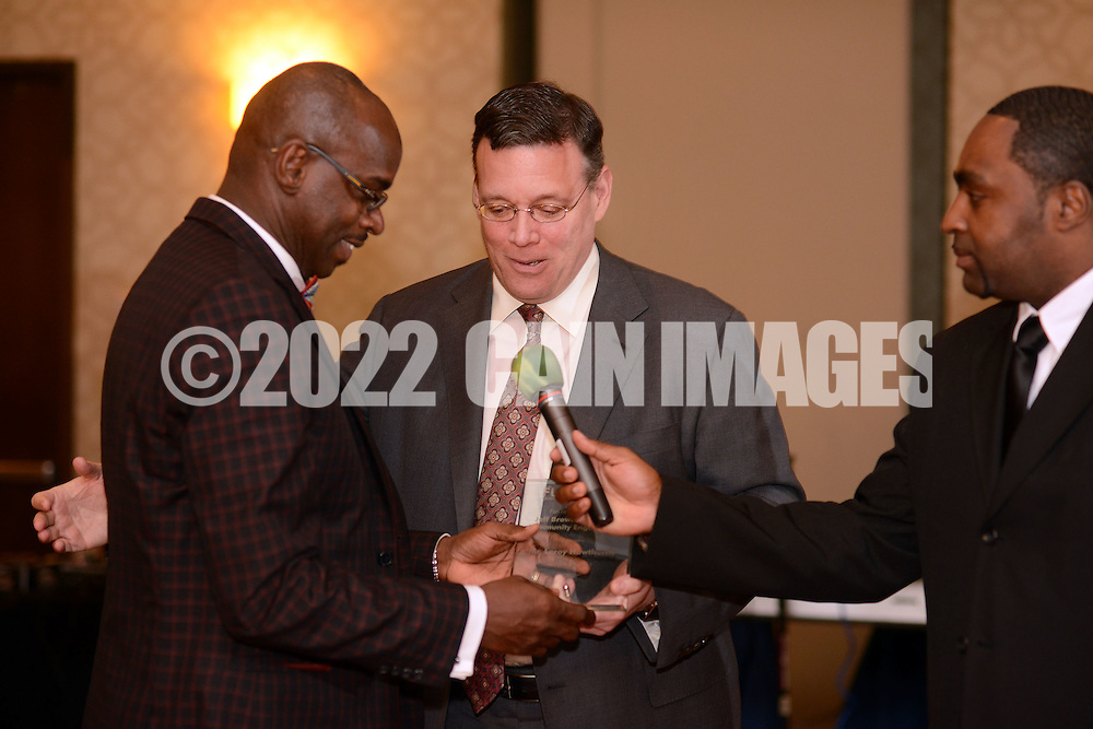 G1FUNN12C<br /> Jeff Brown, (center) CEO of Brown's ShopRite Super Stores presents an award to Leroy Hawthorne (left) as Gregory Campbell (right) holds the microphone during the FunTimes Magazine 5th Annual Gala Saturday October 10, 2015 at the Renaissance Hotel in Philadelphia, Pennsylvania. The event featured a dinner dance as well as the recipients of three awards. (William Thomas Cain/For The Inquirer)