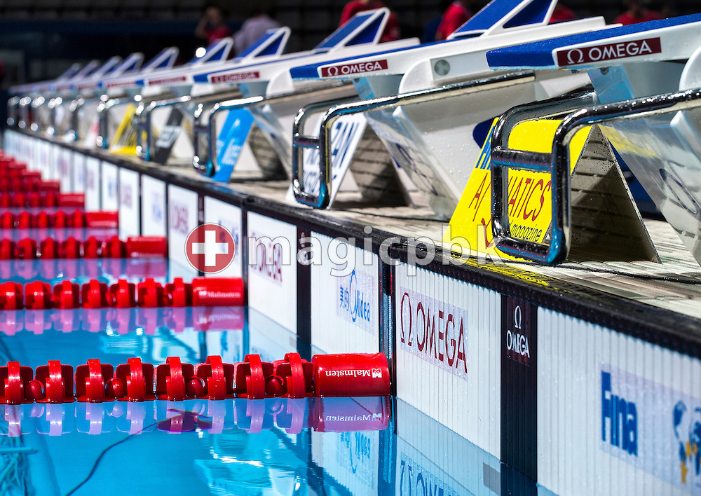 OMEGA OSB11 - starting block with relay break detection - and white OMEGA OCP5 Touchpads are pictured during the 15th FINA World Aquatics Championships at the Palau Sant Jordi in Barcelona, Spain, Saturday, Aug. 3, 2013. (Photo by Patrick B. Kraemer / MAGICPBK)