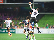 Fiji player Jasa Veremalua bats the ball back to an oncoming teammate at a re start  during Fiji v Japan match  in the Cathay Pacific/HSBC Hong Kong 7s at Hong Kong Stadium, Hong Kong, Hong Kong on 7 April 2017. Photo by Ian  Muir.*** during *** v *** in the Cathay Pacific/HSBC Hong Kong 7s at Hong Kong Stadium, Hong Kong, Hong Kong on 7 April 2017. Photo by Ian  Muir.