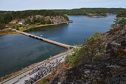 The peloton speed along the shoreline at Ladies Tour of Norway 2018 Stage 3. A 154 km road race from Svinesund to Halden, Norway on August 19, 2018. Photo by Sean Robinson/velofocus.com