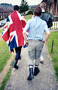 Lee in a Union Jack flag with Neville and Paul on Hawthorne Road, High Wycombe, UK, 1980s.