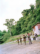 Group of Jawara leaving the ferry landing to return to their jungle camp, Middle Andaman Island