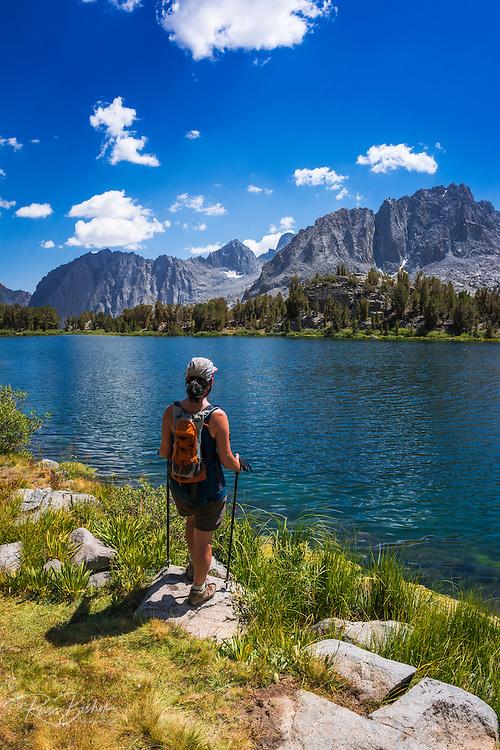 hiker on the shore of Big Pine Lake #6, John Muir Wilderness, Sierra Nevada Mountains, California USA