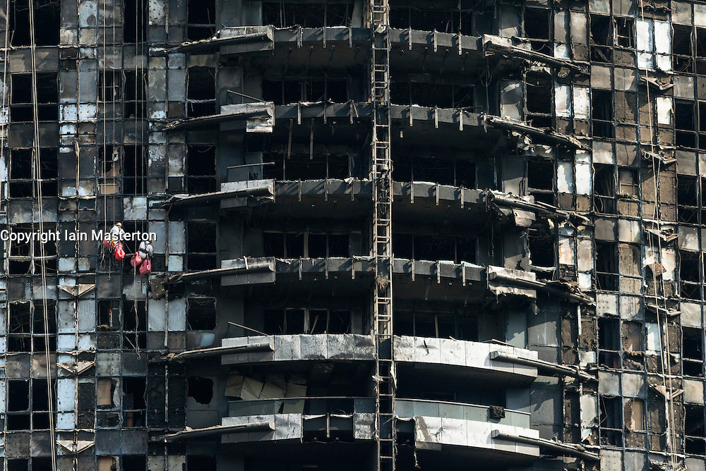 Dubai, United Arab Emirates, January 7, 2015.  Workmen abseiling down the gutted facade of The Address Hotel after fire ravaged the building on New Year's Eve 2015. Inspection and repairs have started and the Hotel is planned to be fully repaired and reopened.