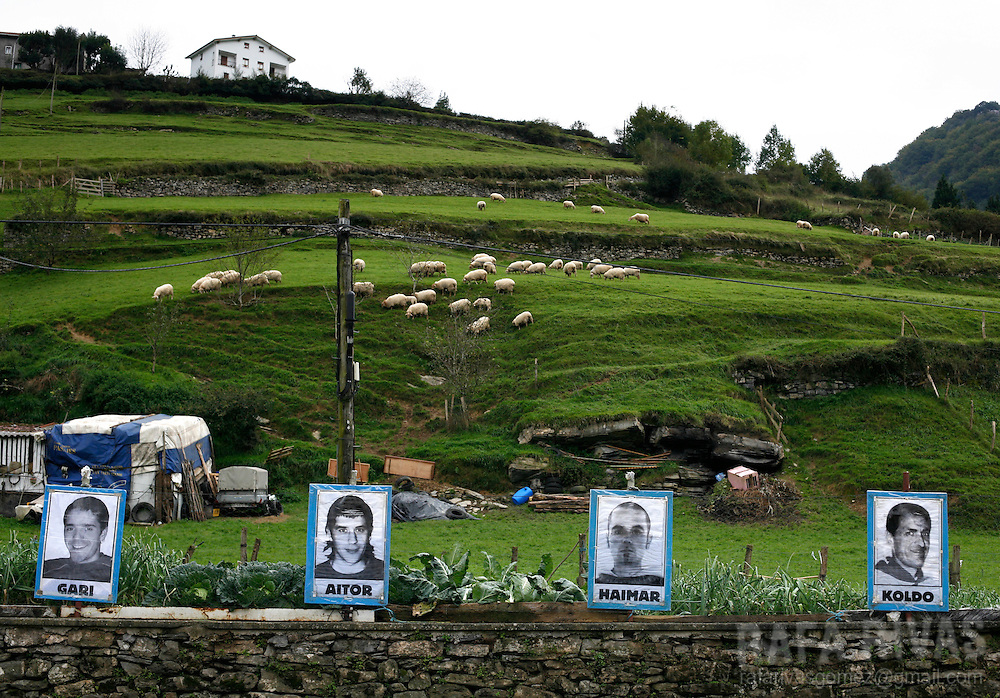 Portraits of imprisoned members of separatist armed Basque group ETA, hang on a fence by a vegetable garden, 18 October 2007, in the northern Spanish Basque village of Lizartza. PHOTO RAFA RIVAS