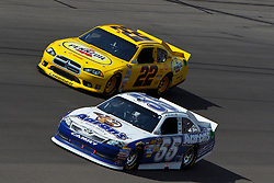Mar 11, 2012; Las Vegas, NV, USA;  Sprint Cup Series driver Mark Martin (55) and driver A.J. Allmendinger (22) during the Kobalt Tools 400 at Las Vegas Motor Speedway. Mandatory Credit: Jason O. Watson-US PRESSWIRE