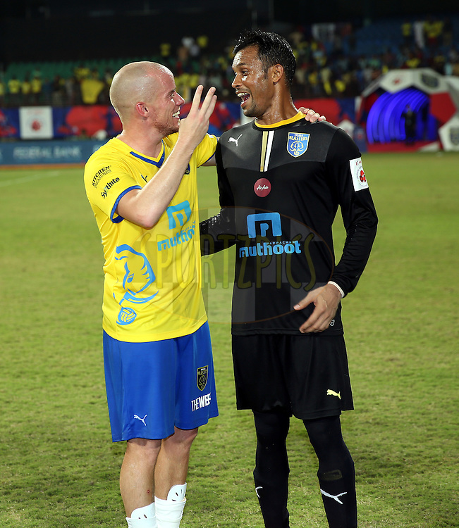 Iain Hume of Kerala Blasters FC and Sandip Nandy of Kerala Blasters FC celebrates after winning the match 54 of the Hero Indian Super League between Kerala Blasters FC and FC Pune City held at the Jawaharlal Nehru Stadium, Kochi, India on the 9th December 2014.<br /> <br /> Photo by:  Sandeep Shetty/ ISL/ SPORTZPICS