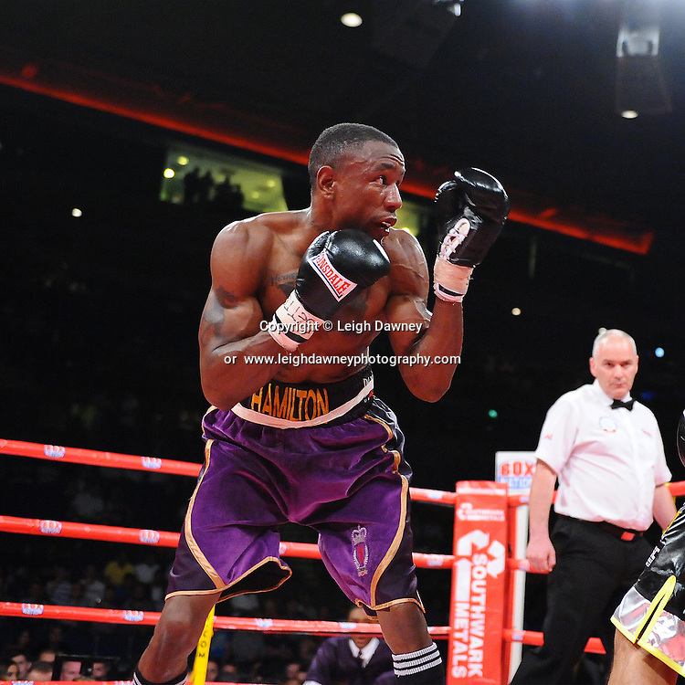 Darren Hamilton (purple shorts) defeats Adil Anwar for the British Light Welterweight Title at the Echo Arena, Liverpool on 6th July 2013. Credit: © Leigh Dawney Photography. Self Billing where applicable. Tel: 07812 790920
