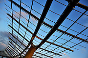 The trellis over lake park at the Mueller development in Austin Texas, August 13 2008.  The Mueller development redeveloped land around the former Austin Mueller International airport into commercial and residential neighborhood. The Browning Hangar was the first hangar built in Austin.  Because of steel shortages during WWII, the hangar was built with laminated wood.