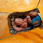 Nepal 2014. Pangma. Baby sleeping in a basket under a scarf to protect from flies and mosquitoes.