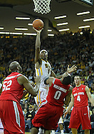 January 04 2010: Iowa Hawkeyes forward Melsahn Basabe (1) puts up a shot over Ohio State Buckeyes forward Jared Sullinger (0) during the first half of an NCAA college basketball game at Carver-Hawkeye Arena in Iowa City, Iowa on January 04, 2010. Ohio State defeated Iowa 73-68.
