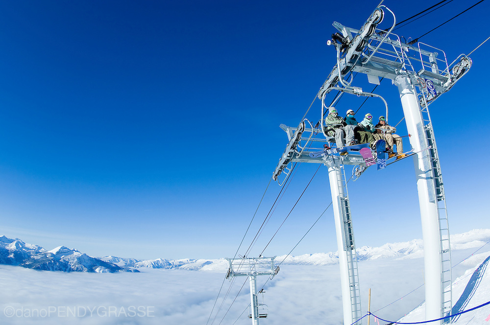 Snowboarders and skiers rise above the clouds at Revelstoke Mountain Resort, a brand new ski resort in Revelstoke, British Columbia, Canada.