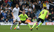 Leeds United striker Chris Wood (9) shields the ball during the Sky Bet Championship match between Leeds United and Brighton and Hove Albion at Elland Road, Leeds, England on 17 October 2015.