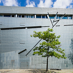 Tree beside modern exterior of Jewish Museum in Kreuzberg Berlin Germany