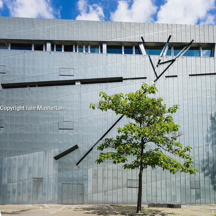 Tree beside modern exterior of Jewish Museum in Kreuzberg Berlin Germany