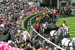 © Licensed to London News Pictures. 17/06/2014. Ascot, UK. HRH Queen Elizabeth ii enters the parade ring.  Day one at Royal Ascot 17th June 2014. Royal Ascot has established itself as a national institution and the centrepiece of the British social calendar as well as being a stage for the best racehorses in the world. Photo credit : Stephen Simpson/LNP