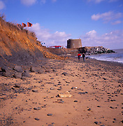 A294P7 Martello tower and beach walkers cliff eroded by the sea Bawdsey Suffolk England