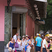 Tourists wait outside the history filled El Floridita, home to the famous daiquiri. The bar was frequented by Ernest Hemingway among other well known international and local celebrities. The bar is a must stop by visitors to Cuba, located in La Habana Vieja or Old Havana on the famous Calle Obispo.<br />