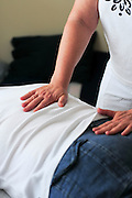 Female masseuse treating a patient
