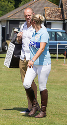 Zara Phillips  with husband Mike Tindall.<br /> A pregnant Zara Phillips plays in the Eventers vs Riders charity Polo The Rundle Cup, whilst husband Mike Tindall watches on at Tidworth Polo Club,Wiltshire, United Kingdom<br /> Saturday, 13th July 2013<br /> Picture by i-Images