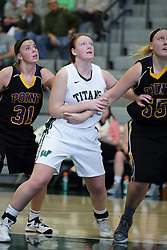 12 December 2015:  Autumn Hennes, Maddie Merritt and Joann Wolfenberg during an NCAA women's basketball game between the Wisconsin Stevens Point Pointers and the Illinois Wesleyan Titans in Shirk Center, Bloomington IL