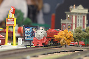 A holiday themed 'O' guage model engine makes its way around the main display table at the 2009 Festival of Trains at the Grand Traverse Heritage Center on Traverse City, Michigan.