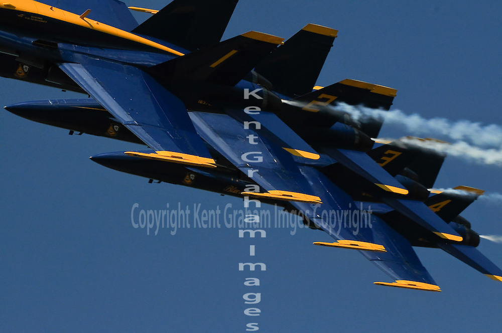 Blue Angels fly in formation as close as twelve inches apart.