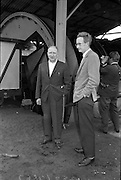 15/06/1963.06/15/1963.15 June 1963.Finnish visitors tour Bord na Mona works..the 48 members of the Finnish Peat Society, who arrived in dublin on Friday 14/06/1963, toured Bord na Mona works in Offaly and Kildare on Saturday. (l-r) Mr. V. Puustjarvi, University of Helsinki and Mr. P. McEvilly, Manager Croghan Briquette Factory at Croghan briquette factory near Mount Lucas, Co. Offaly.